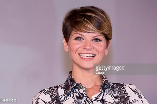 Italian singer Alessandra Amoroso smiles during a press conference on November 11 2015 in Mexico City Mexico