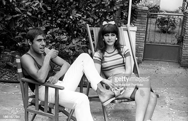 Italian singer and actor Adriano Celentano and his wife Italian singer and actress Claudia Mori having a rest during a holiday in Versilia Le Focette...