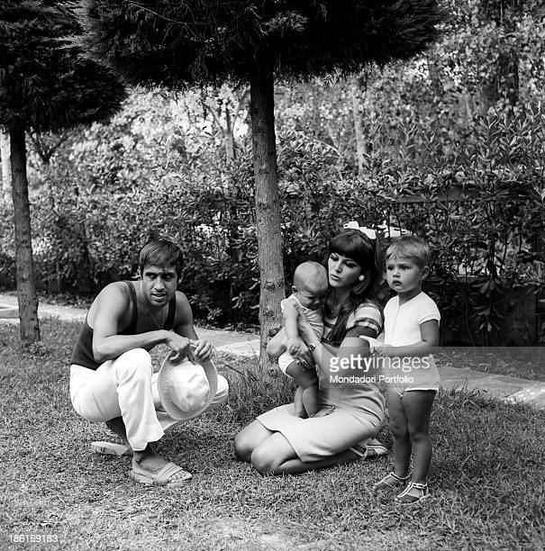Italian singer and actor Adriano Celentano and his wife Italian actress Claudia Mori relaxing with their children Rosita and Giacomo Celentano Le...