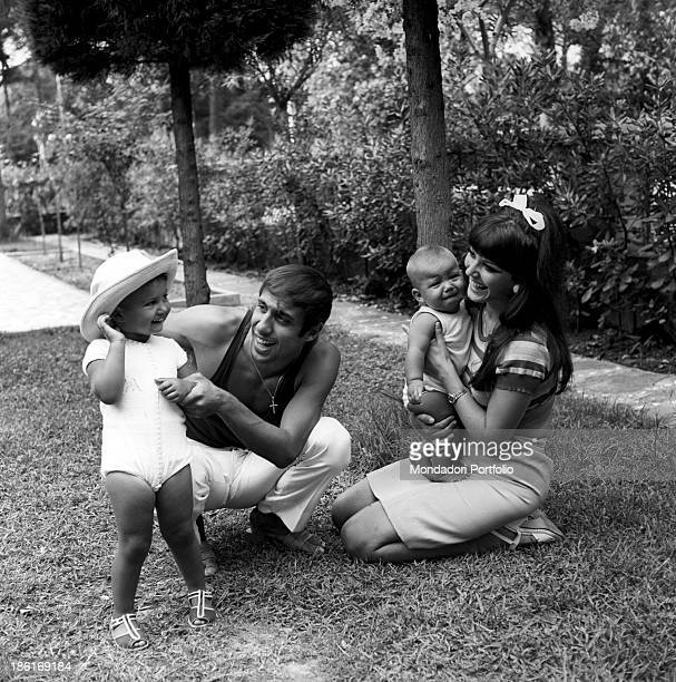 Italian singer and actor Adriano Celentano and his wife Italian actress Claudia Mori smiling with their children Rosita and Giacomo Celentano Le...