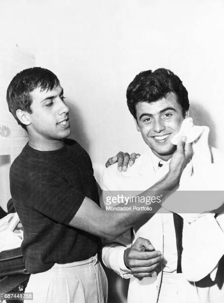 Italian singer and actor Adriano Celentano and the Sammarinese singer Little Tony joking in the backstage of XI Sanremo Music Festival. The two...