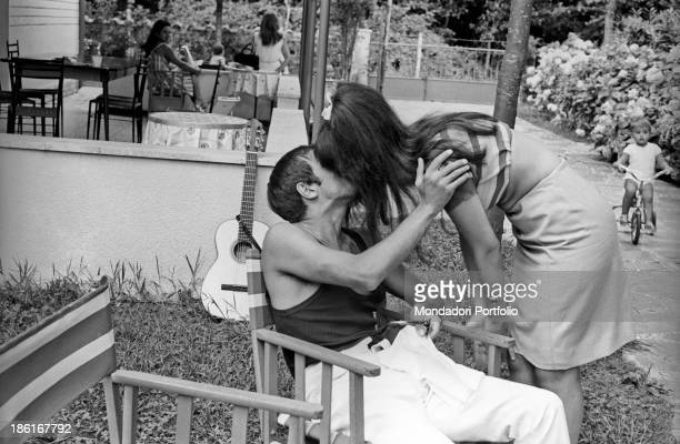Italian singer and actor Adriano Celentano kissing his wife Italian actress Claudia Mori Le Focette August 1967