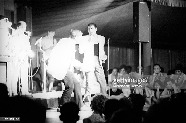 Italian singer and actor Adriano Celentano performing in a concert at La Bussola club Le Focette August 1967