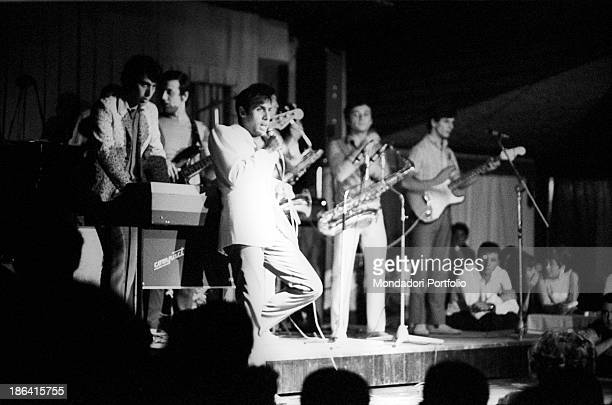 Italian singer and actor Adriano Celentano performing in a concert in the club La Bussola Le Focette August 1967