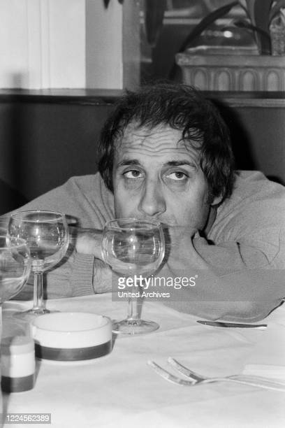 Italian singer and actor Adriano Celentano visiting an Italian restaurant at Hamburg, Germany circa 1982.