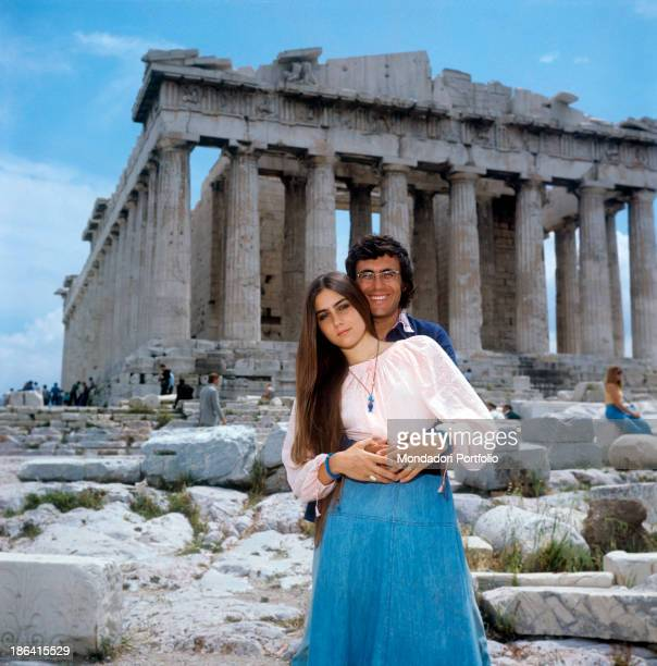 Italian singer and actor Al Bano and Americanborn Italian singer Romina Power posing hugging during a visit to the Acropolis of Athens Athens 1975