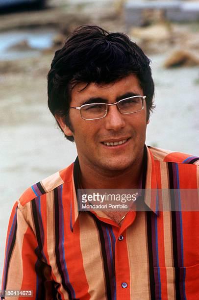 Italian singer and actor Al Bano posing smiling on the beach of Punta Ala Punta Ala 1968