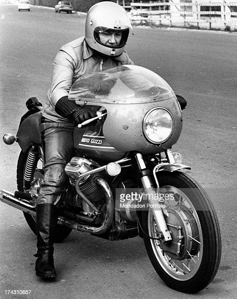 Italian singer and actor Claudio Villa is in the saddle of a motorcycle Moto Guzzi Rome 1960s