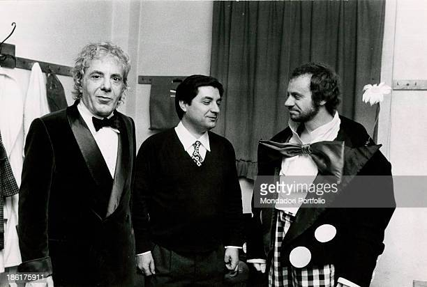 Italian singer and actor Johnny Dorelli Italian actor Gianrico Tedeschi and Italian director Emilio Bruzzo having a break behind the scenes of the...