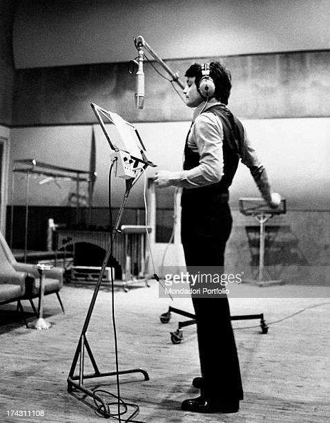 Italian singer and actor Massimo Ranieri singing in a recording studio Rome 1970s