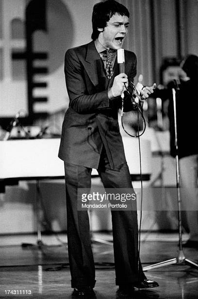 Italian singer and actor Massimo Ranieri singing on a stage Venice 1970s