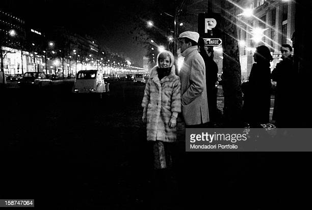 Italian singer and actor Teddy Reno and Italianborn Swiss actress and singer Rita Pavone walking in a street in Paris during a break of the song...