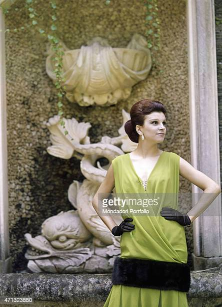 Italian singer and actress Milva posing in the garden of Villa Castelli in a green dress with fur applications made by Italian dressmaker and fashion...