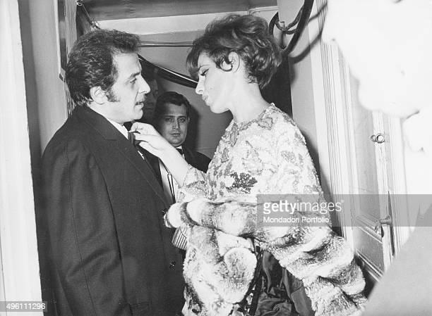 Italian singer and actress Ornella Vanoni talking with the Italian singer Domenico Modugno straightening his bow tie during the 17th Sanremo Music...