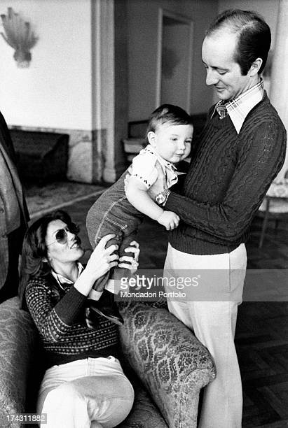 Italian singer and record producer Caterina Caselli and her husband Italian record producer Piero Sugar holding their son Filippo Sugar in their arms...