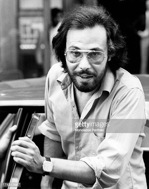 Italian singer and songwriter Antonello Venditti getting out of a car Rome 1970s