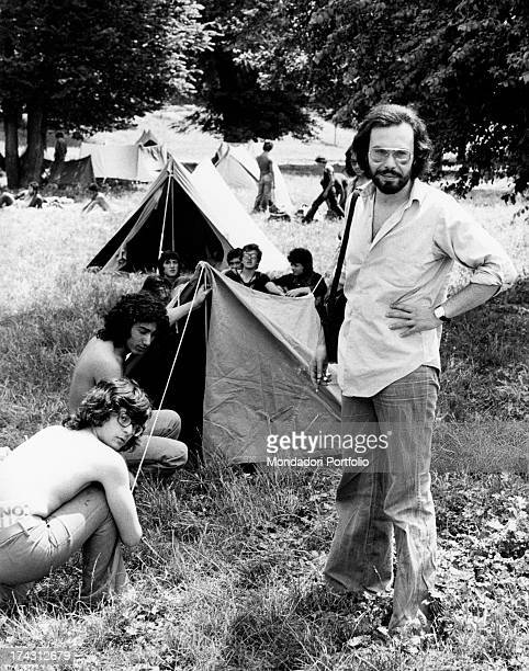 Italian singer and songwriter Antonello Venditti in a camping Some young people are pitching a tent Rome 1970s