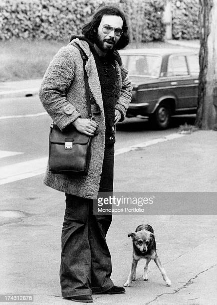 Italian singer and songwriter Antonello Venditti posing beside a dog Rome 1970s