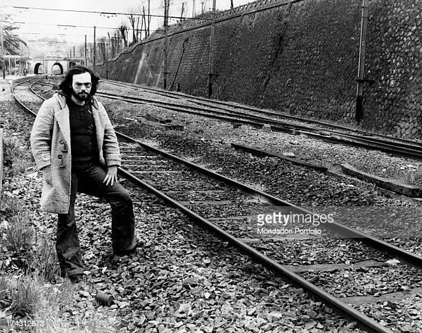 Italian singer and songwriter Antonello Venditti posing the rails Rome 1970s