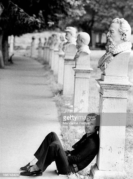 Italian singer and songwriter Franco Califano posing leaning on the bust of a Risorgimento partisan on the Janiculum hill Rome 1972