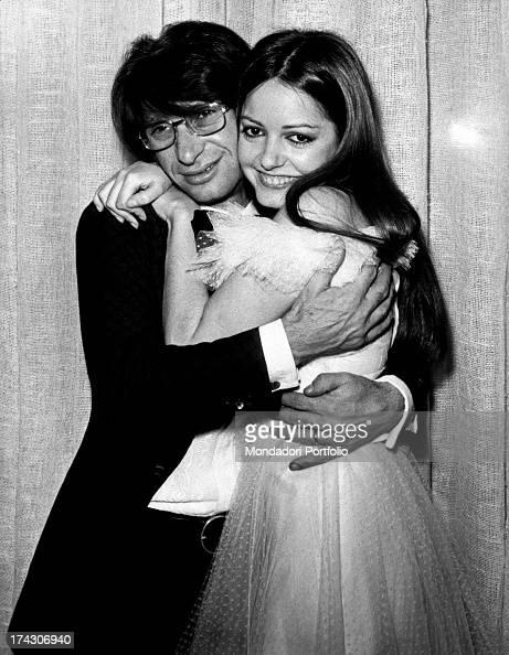 Italian singer and songwriter Nicola di Bari hugging ...