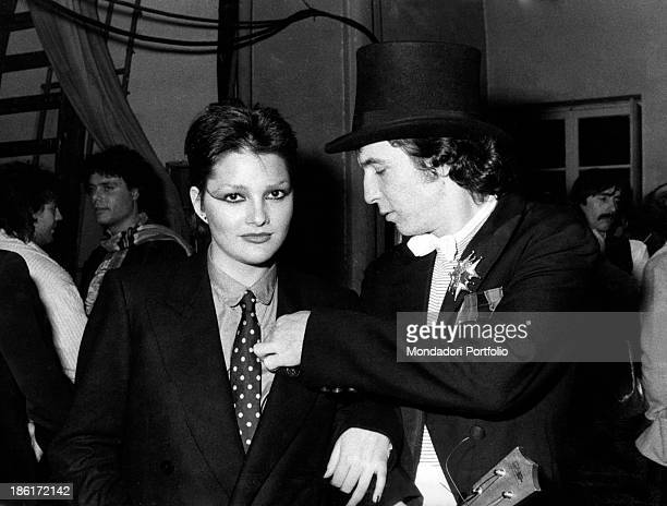 Italian singer and songwriter Rino Gaetano tidying up the lapel of Italian singer Anna Oxa at 28th Sanremo Music Festival Sanremo 1978