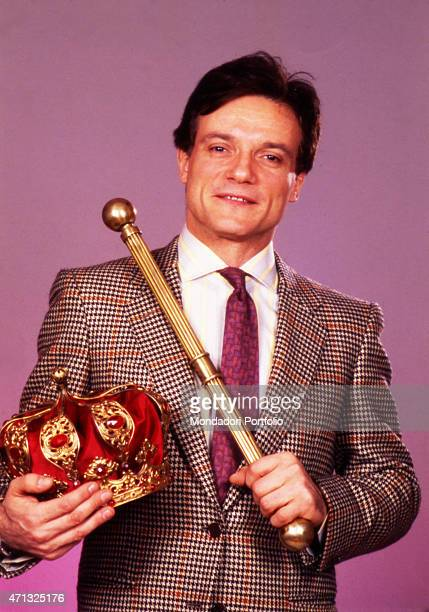 Italian singer and theatre actor Massimo Ranieri holding a royal crown and a sceptre in a photo shooting inside a studio Italy 1988