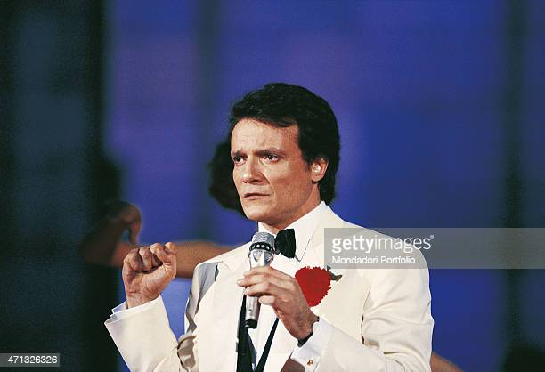 Italian singer and theatre actor Massimo Ranieri in a white dinnerjacket presenting the Tv variety show 'Fantastico 10' Rome 1989