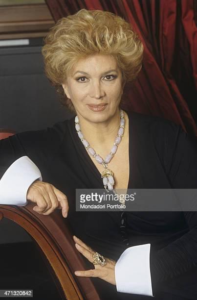 Italian singer and TV presenter Iva Zanicchi at Italian fashion designer Gianfranco Ferr's atelier on via Pontaccio Milan 2000