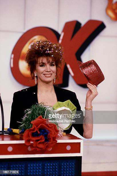Italian singer and TV presenter Iva Zanicchi showing a red hat in the TV quiz The price is right Cologno Monzese 1989
