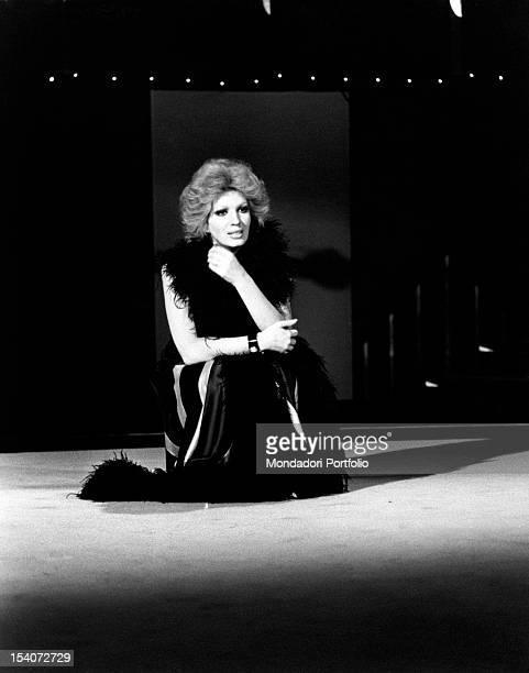 Italian singer and TV presenter Iva Zanicchi taking part in the rehearsal of variety show Totambot Italy 1975