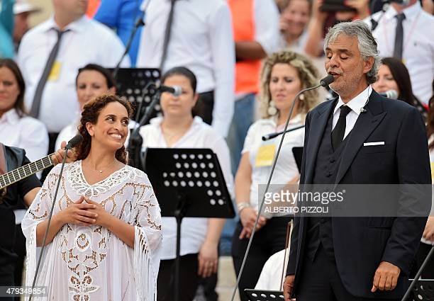 Italian singer Andrea Bocelli and Israeli singer Noa perform prior to the arrival of Pope Francis for a meeting with the Renewal in the Holy Spirit...