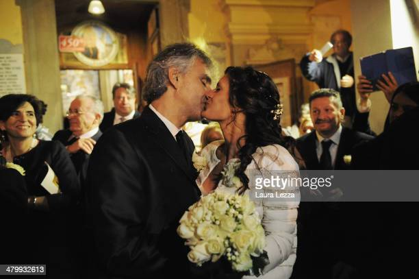 Italian singer Andrea Bocelli and Veronica Berti kiss at Sanctuary of Madonna di Montenero after their wedding on March 21 2014 in Livorno Italy