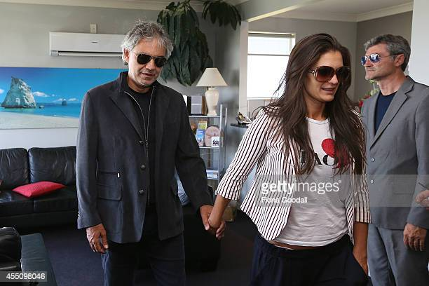 Italian singer Andrea Bocelli arrives with his wife Veronica Berti at the Auckland International Airport on September 10 2014 in Auckland New Zealand