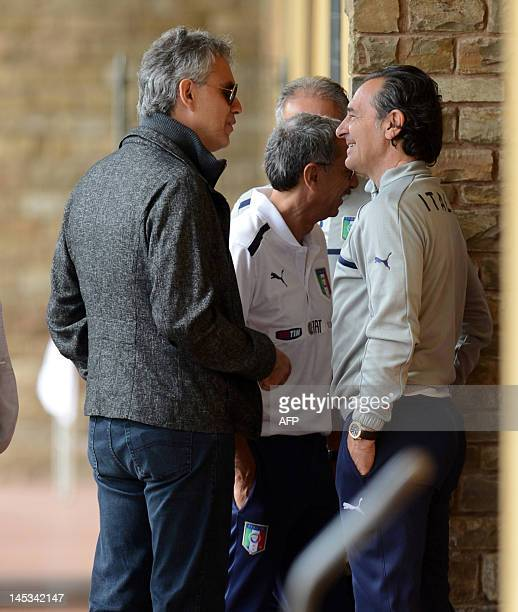 Italian singer Andrea Bocelli arrives with Italian coach Cesare Prandelli for a national football team training session in Firenze on May 27 2012 AFP...