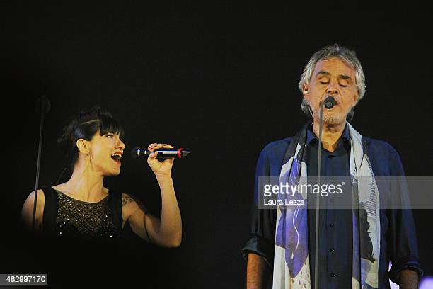 Italian singer Andrea Bocelli performs on stage with Italian singer Elisa at Teatro del Silenzio during the 10th edition of Andrea Bocelli's Teatro...