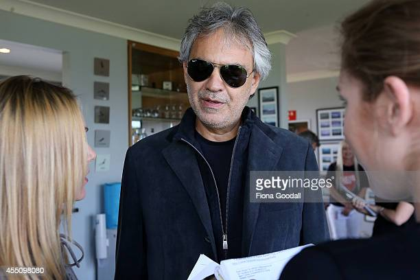Italian singer Andrea Bocelli speaks to media after he arrives with his family at the Auckland International Airport on September 10 2014 in Auckland...