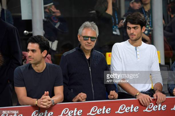 Italian singer Andrea Bocelli with his sons Amos Bocelli and Matteo Bocelli are seen in the stands before the Italian Serie A football match Inter...