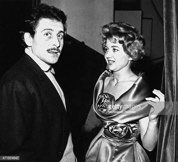Italian singer Anna D'Amico looking at Italian singersongwriter Domenico Modugno at 9th Sanremo Music Festival Sanremo January 1959
