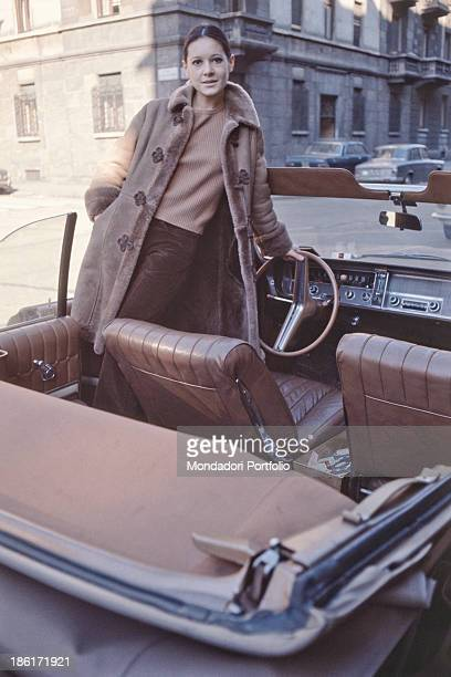 Italian singer Anna Identici posing standing in a convertible car The artist takes part in the 18th Sanremo Music Festival Sanremo February 1968