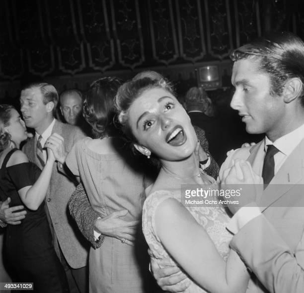 Italian singer Anna Maria Alberghetti dances with Bob Evans at the Cocoanut Grove in Los Angeles California