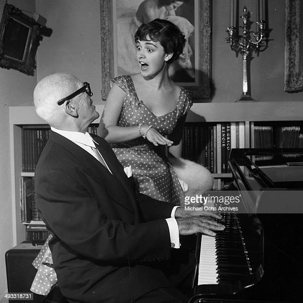 LOS ANGELES CALIFORNIA AUGUST 22 1954 Italian singer Anna Maria Alberghetti sings with Jimmy McHugh during a party in Los Angeles California
