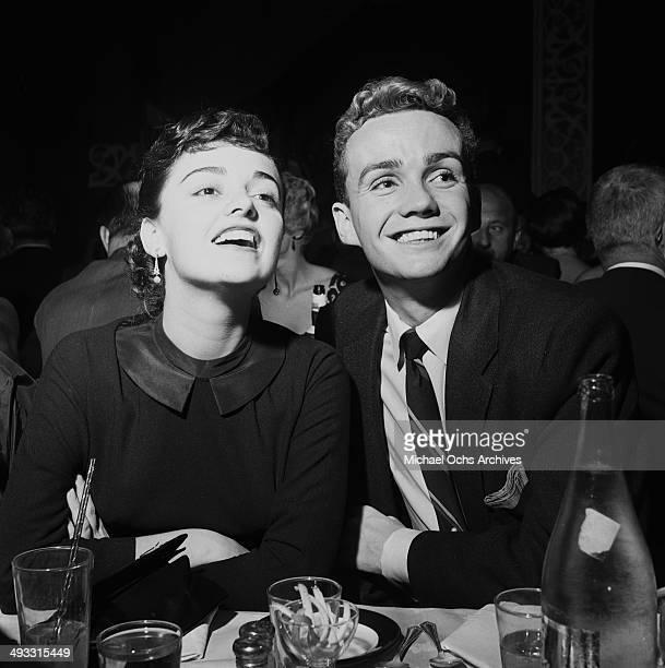 LOS ANGELES CALIFORNIA JANUARY 11 1955 Italian singer Anna Maria Alberghetti with Ben Cooper at dinner at Ciro's in Los Angeles California