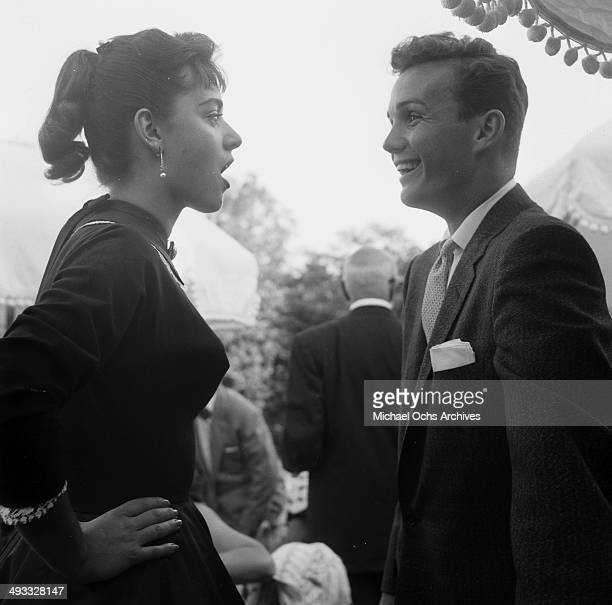 Italian singer Anna Maria Alberghetti with Ben Cooper at the Jimmy McHugh party in Los Angeles California