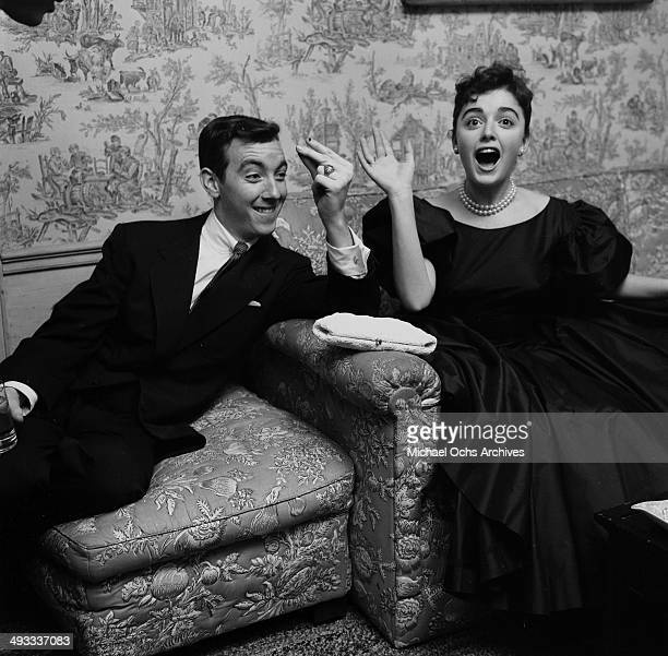 LOS ANGELES CALIFORNIA FEBRUARY 25 1956 Italian singer Anna Maria Alberghetti with Jack Haley Jr attend a party in Los Angeles California