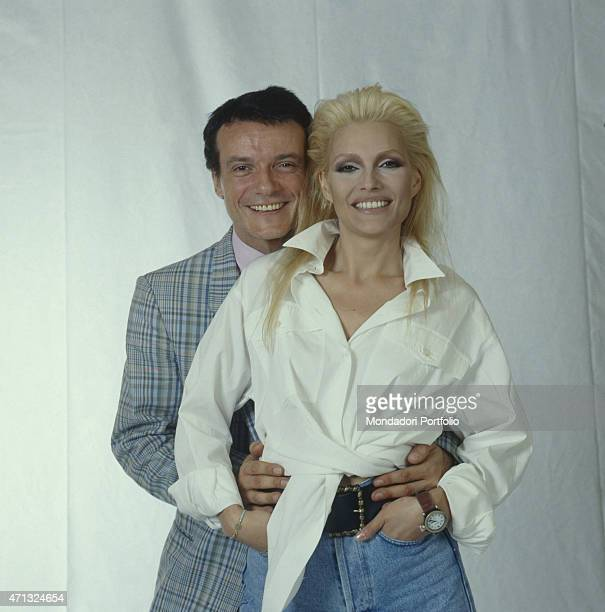 Italian singer Anna Oxa and Italian singer and actor Massimo Ranieri posing smiling The artists present the TV variety show Fantastico 10 1989