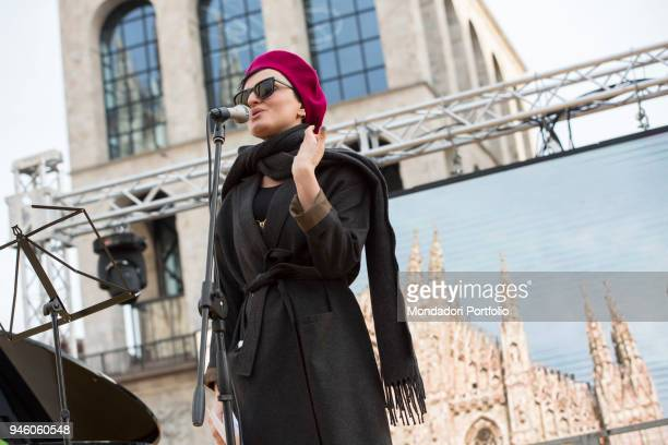 Italian singer Arisa performs in piazza Duomo during the event Il futuro é donna for the women's rights conceived by italian singer Jo Squillo Milan...