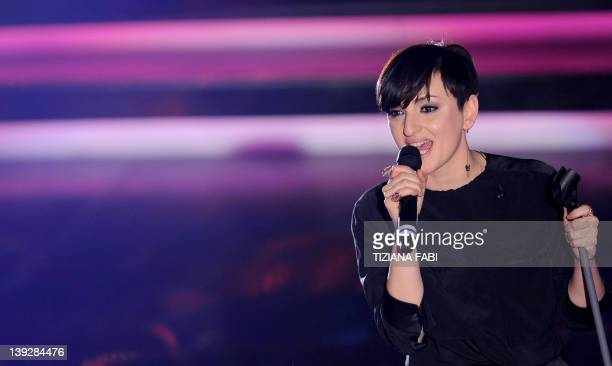 Italian singer Arisa performs on the stage of Ariston Theatre in Sanremo during the 62nd Italian Music Festival on February 18 2012 AFP PHOTO/...