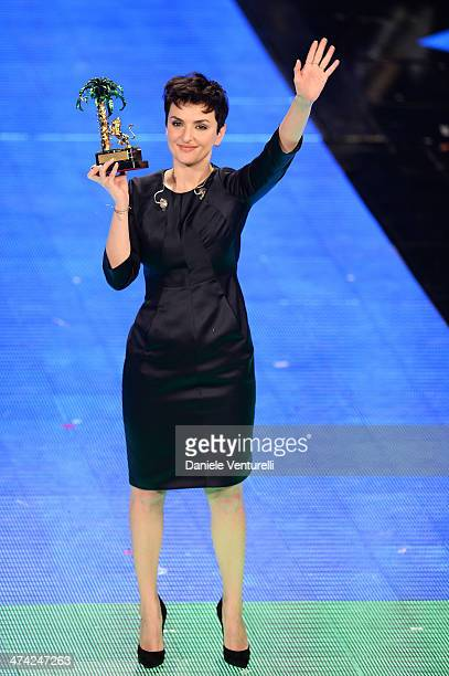 Italian singer Arisa winner of the 64th Italian Music Festival in Sanremo poses with his trophy at the Ariston theatre during the closing night on...
