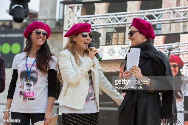 Italian singer Arisa with Giusy Versace and Jo Squillo in piazza Duomo during the event Il futuro é donna for the women's rights conceived by...